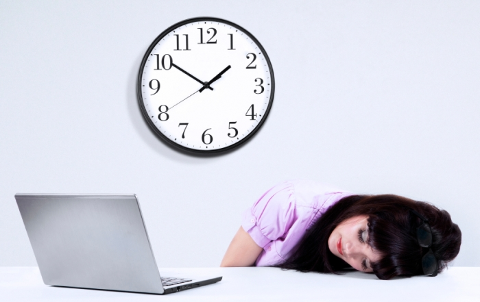 Businesswoman sleeping on desk in office